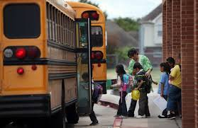 Students loading school bus