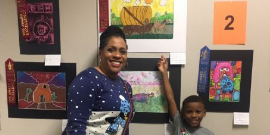 2nd Place HLS&R Art Finalist Bryton Field stands proudly by his Artwork alongside art teacher Ms. O.