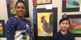 1st Place HLS&R Finalist Metexca Nguyen stands proudly by her Artwork alongside art teacher Ms. O.