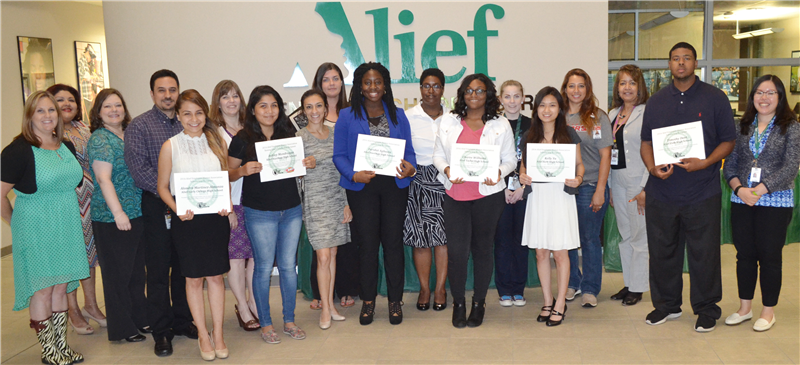Photo of Alief Employee Alumni Association scholarship recipients with organization members