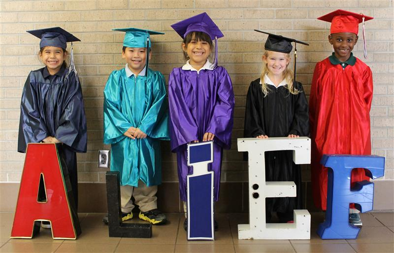 Photo of kindergarteners with graduation outfits
