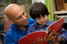 Boy and dad reading