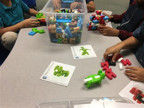 Students building with IO blocks