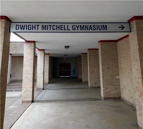 Dwight Mitchell Gymnasium Banner in front of gym