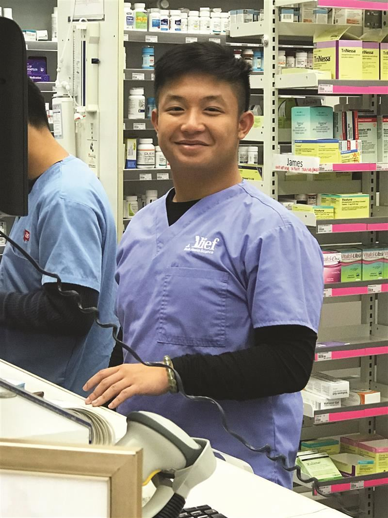 Photo of a CTE student working in a pharmacy