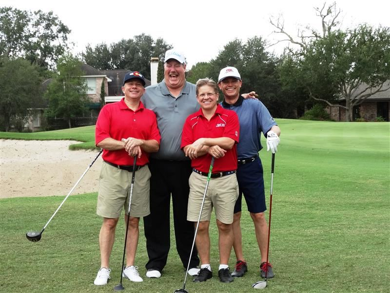 Photo of four golfers from the 2017 Education Foundation Golf Tournament fundraiser