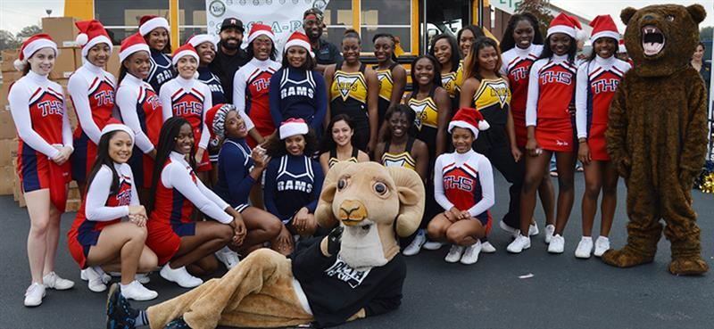 Photo of Alief ISD cheerleaders supporting the Stuff A Bus event