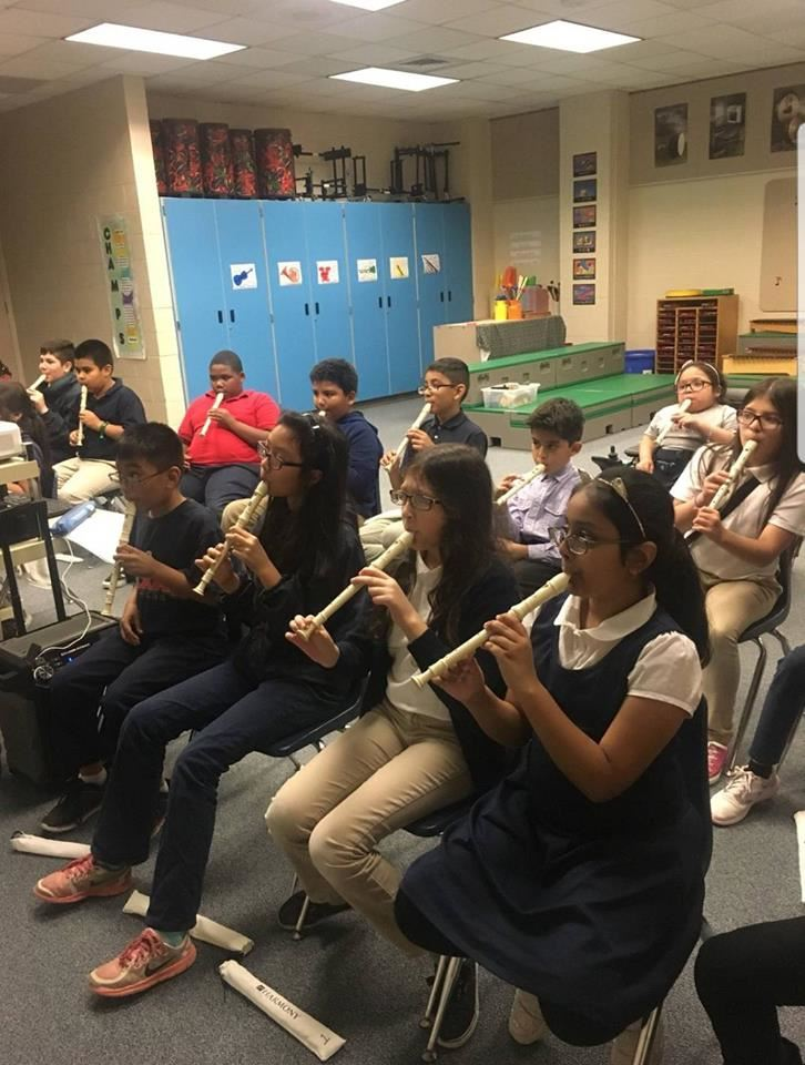 students playing recorders