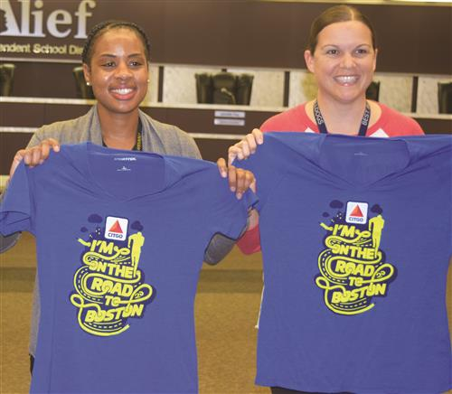 Krystle Dunn and Courtney Rees with CITGO t-shirts