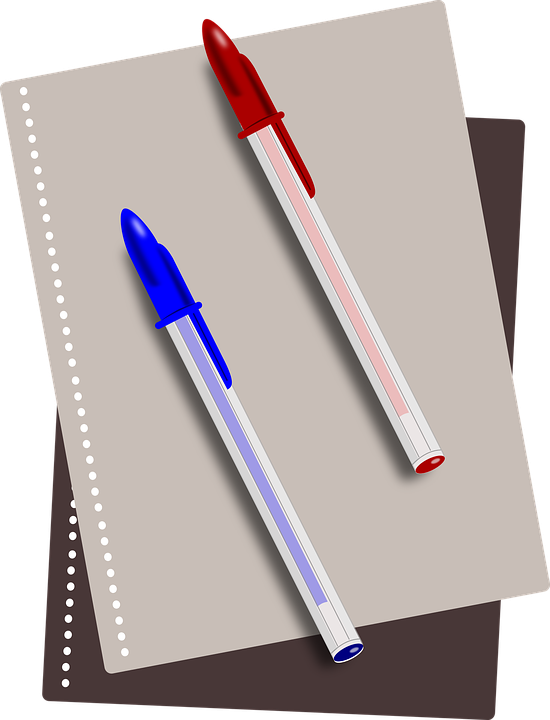 A picture of a notebook and a red and blue pen