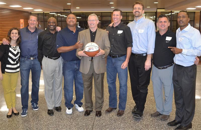 Photo of Rick Sherley with the 1987 team before the gym dedication ceremony